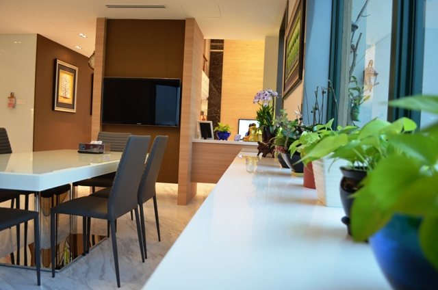 Pebbel Bay Pent House Modern Kitchen with Dinning table deep view to living hall Contact