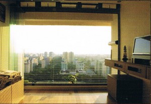 smart windows neatly parked panels when open 300x207 Frameless Windows Solution – Transform Your Home Balcony into a Comfortable Living Space