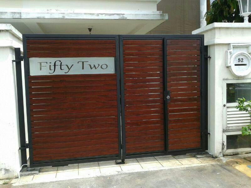 Aluminium Wood Grain Design with side door for landed car driveway gate Custom Swing or Slide Driveway Gate and Gate Ornamentals for Singapore Commercial and Residential Landed Private Properties: Stainless Steel, Wrought Iron, Mild Steel and Timber / Aluminium Wood Grain Designs