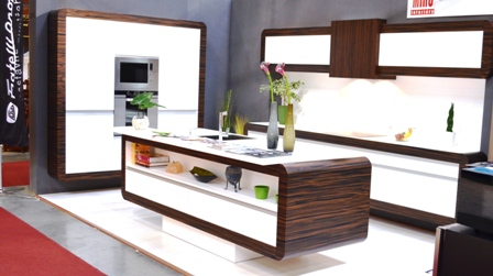 Kitchen design with island white body with wooden design frame built oven and mircowave Miro Interiery Czech Republic1 Kitchen Designs by Inspired European Furniture and Home Designs: Furniture and Interior Design Fair in Exhibition Centre, Letnany