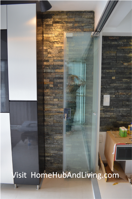 Singapore Frameless Door With Flying Door Design Collapsed To Side Wall  With Cabinet 2 199x300 Official