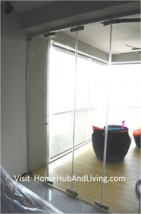 Singapore Private Property Fully Closed Frameless Door Enjoy privacy in balcony area side view 198x300 Official Site of Latest Frameless Doors System & Flying Door Designs: Space Design Solutions for protecting Home Balcony, Patio, Room Dividers, Home Office, Office Partition and more!