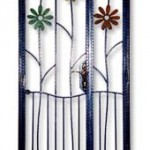 wrought iron gate with color flowers and higher ground