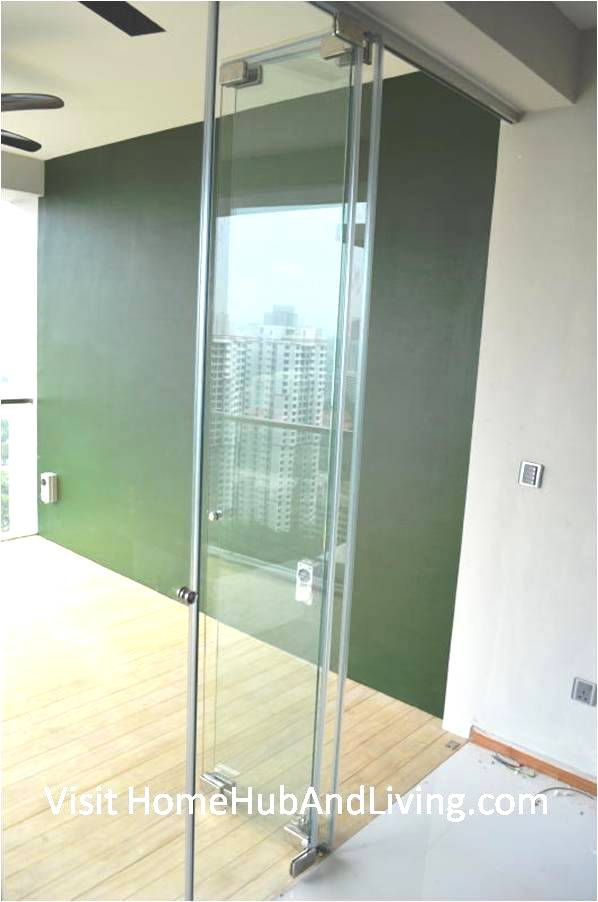 Partial Frameless Door Opened for Ventilation Side Green Balcony Wall View Robust Innovative Glass System True Open Concept Design with Living Room and Balcony: Enjoy Full View and New Define Feeling of Balcony Space
