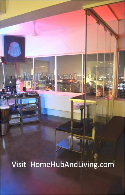 Side Frameless Door Uses as Clear Transparent Partition between the Open DJ Deck And The Balcony Area for Privacy Area Friends & Family House Party Events: Frameless Door Creatively Served as Multi Purpose Flexible Glass Room & Partition for Privacy