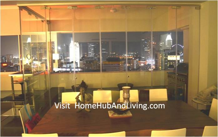 Unobstructed View by Frameless Door Leaving Wide Full City Night Scene As Beautiful Picture. With Aircon Turn On Inside Living Room Singapore Luxury High End City Residential Designer House Prefer Frameless Door System for Creative Outdoor Balcony Designs with Flexible Glass Room for Meeting, Chill Out / Smoking Area or Turning into Barbeque with Charcoal Grill Equipment