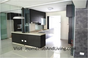 Counter Top and Kitchen Entrance Frameless Door Opened side view from living room 300x199 Stylish Designed Modern Kitchen (Counter Top Island) with Frameless Door System Designs as Kitchen Partitions