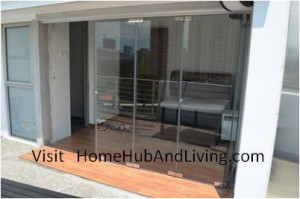 Balcony Side Partial For Bigger Opening 300x199 Frameless Door System and Flying Door Design: Enjoy Up Close Full Nature Outdoor Sky View Beauty Experiences Direct from Singapore Penthouse Bedroom Through Unblock Balcony Open Spaces